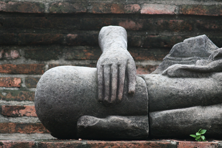Destroyed Buddha figure in the historical park of Ayutthaya.