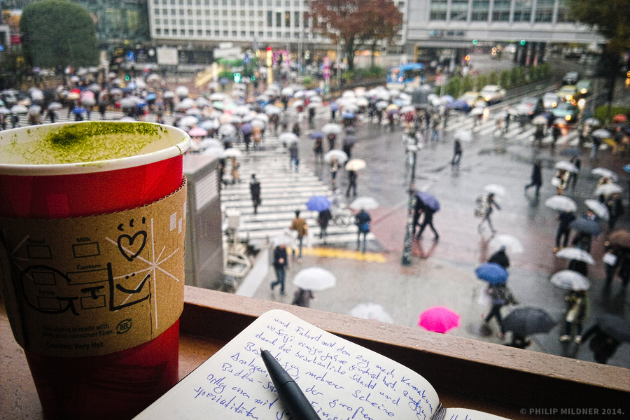 Enjoying a hot and warming Green Tea Latte at Shibuya Station, Tokyo.
